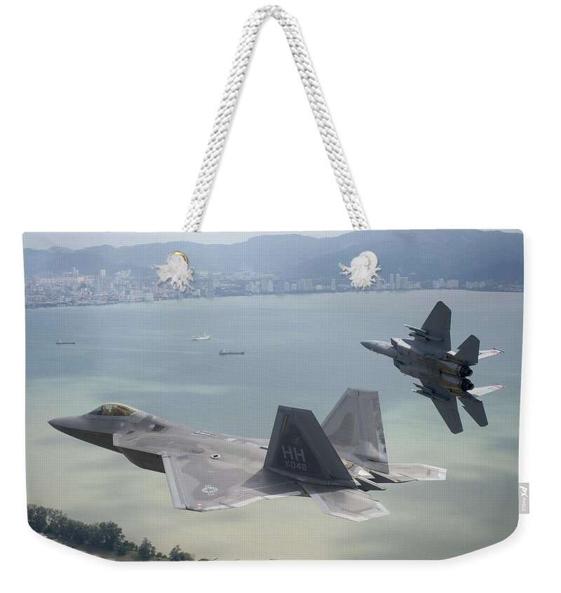 Weekender Tote Bag featuring the photograph Raptor And Eagle by Paul Fearn