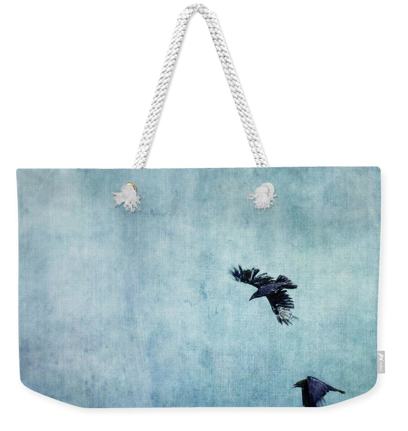 Minimalistic Weekender Tote Bag featuring the photograph Ravens Flight by Priska Wettstein