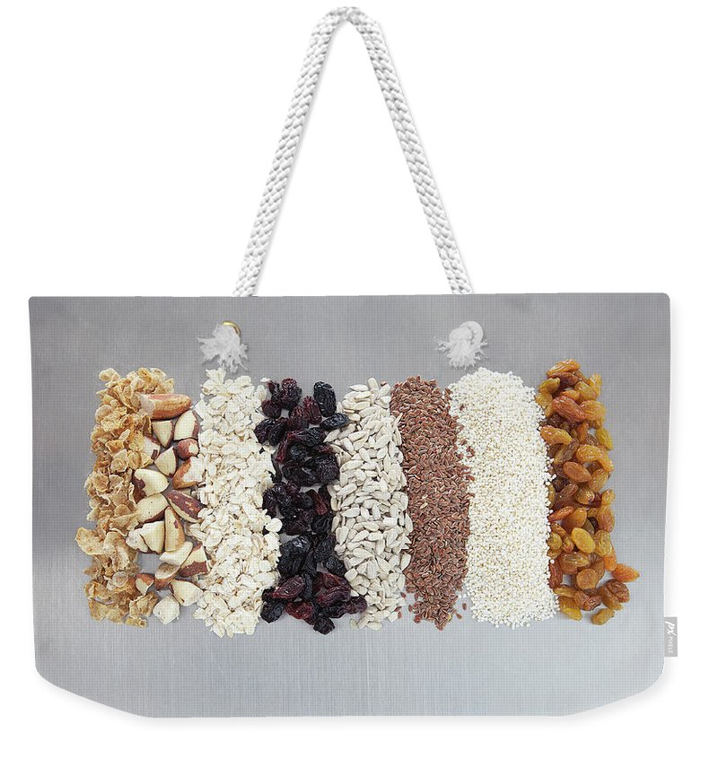 Nut Weekender Tote Bag featuring the photograph Raw Nuts, Dried Fruit And Grains by Laurie Castelli