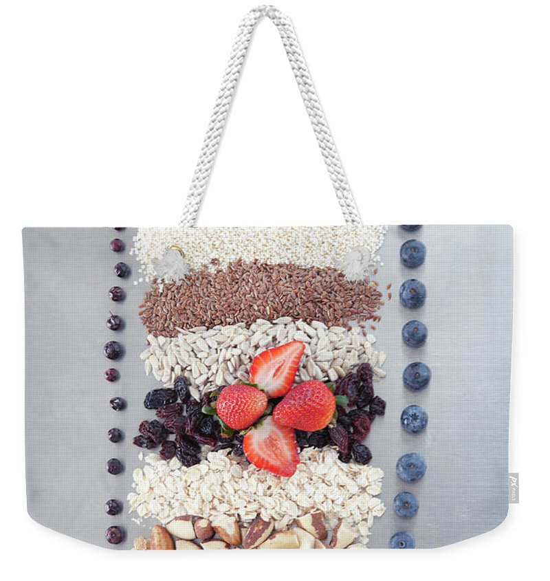 Nut Weekender Tote Bag featuring the photograph Raw Nuts, Fruit And Grains by Laurie Castelli