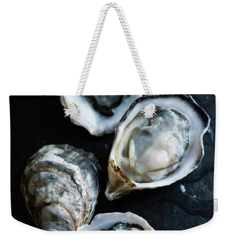 Oyster Weekender Tote Bag featuring the photograph Raw Oysters by Jack Andersen