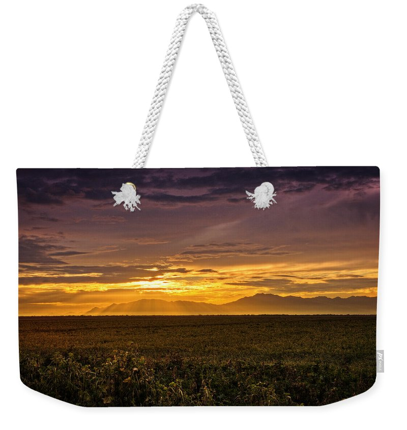 Sunset Weekender Tote Bag featuring the photograph Rays Of Hope by Saija Lehtonen