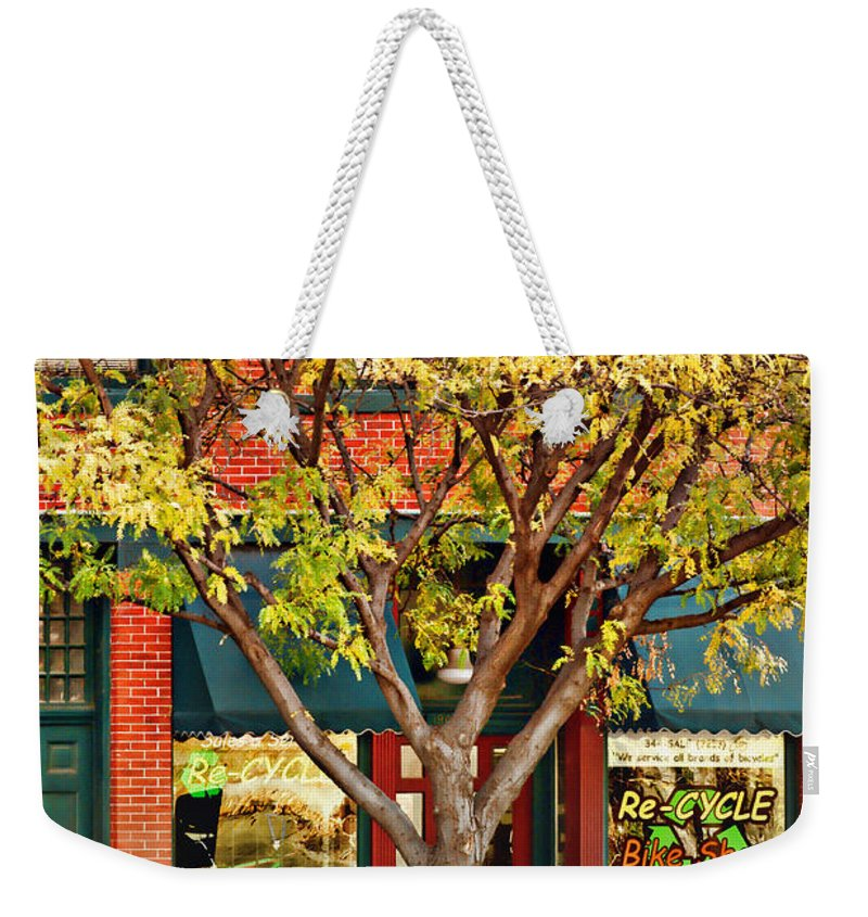 Recycle Weekender Tote Bag featuring the photograph Re-cycle Bike Shop by Nikolyn McDonald
