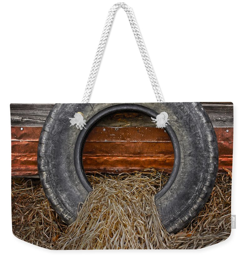 Tire Weekender Tote Bag featuring the photograph Re Tired by The Artist Project