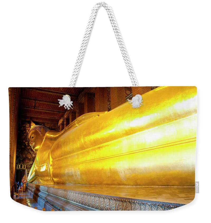 Statue Weekender Tote Bag featuring the photograph Reclining Buddha, Wat Pho by Leontura