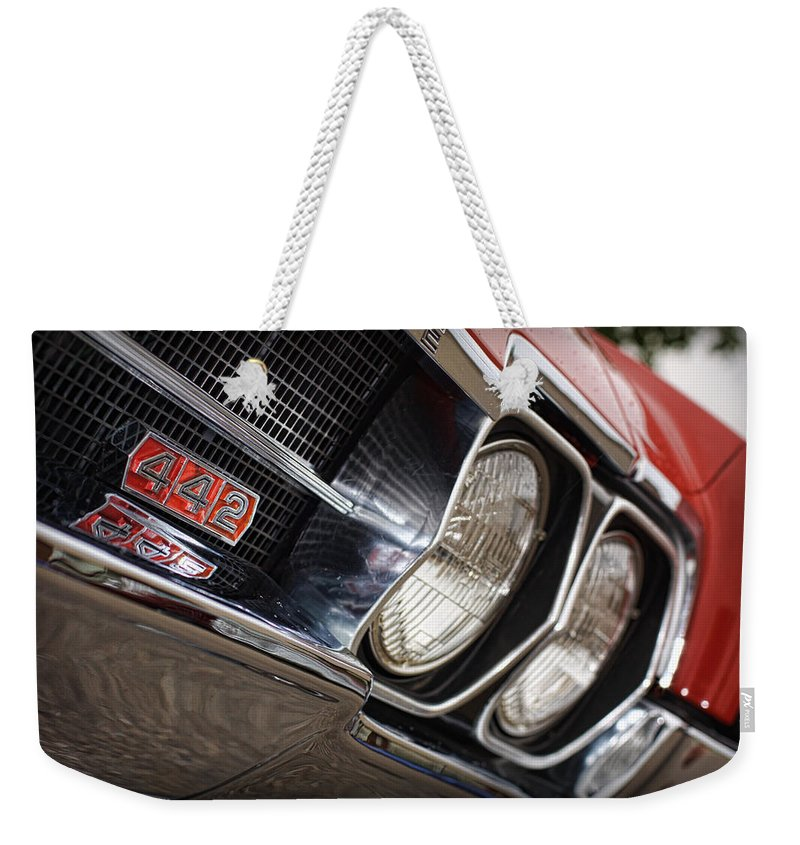 Red Weekender Tote Bag featuring the photograph Red 1966 Olds 442 by Gordon Dean II