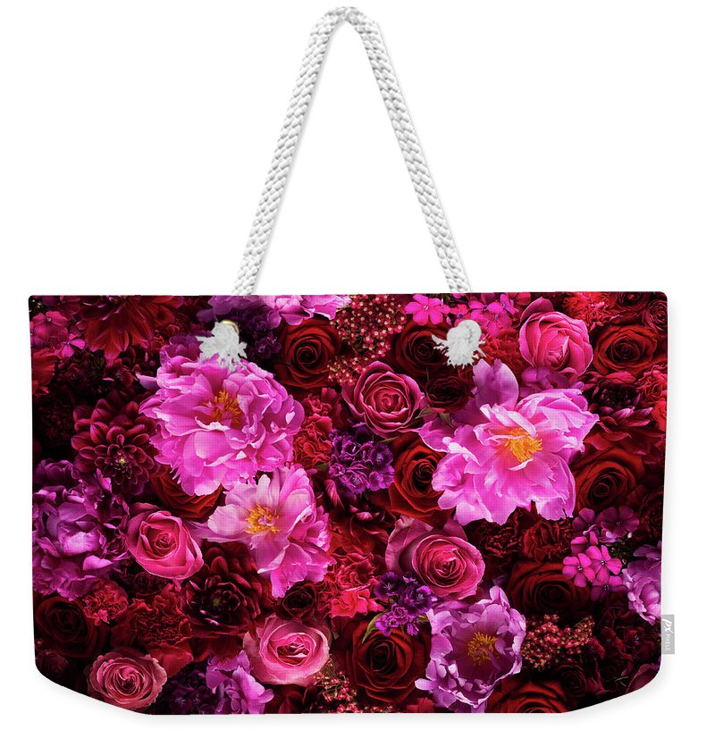 Tranquility Weekender Tote Bag featuring the photograph Red And Pink Cut Flowers, Close Up by Jonathan Knowles
