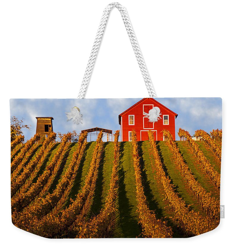 Red Weekender Tote Bag featuring the photograph Red Barn In Autumn Vineyards by Garry Gay