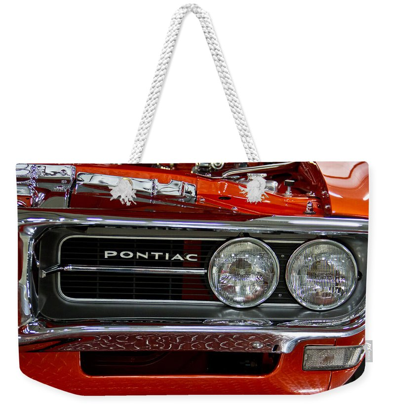 Customized Weekender Tote Bag featuring the photograph Red Customized Retro Pontiac-front Left by Eti Reid