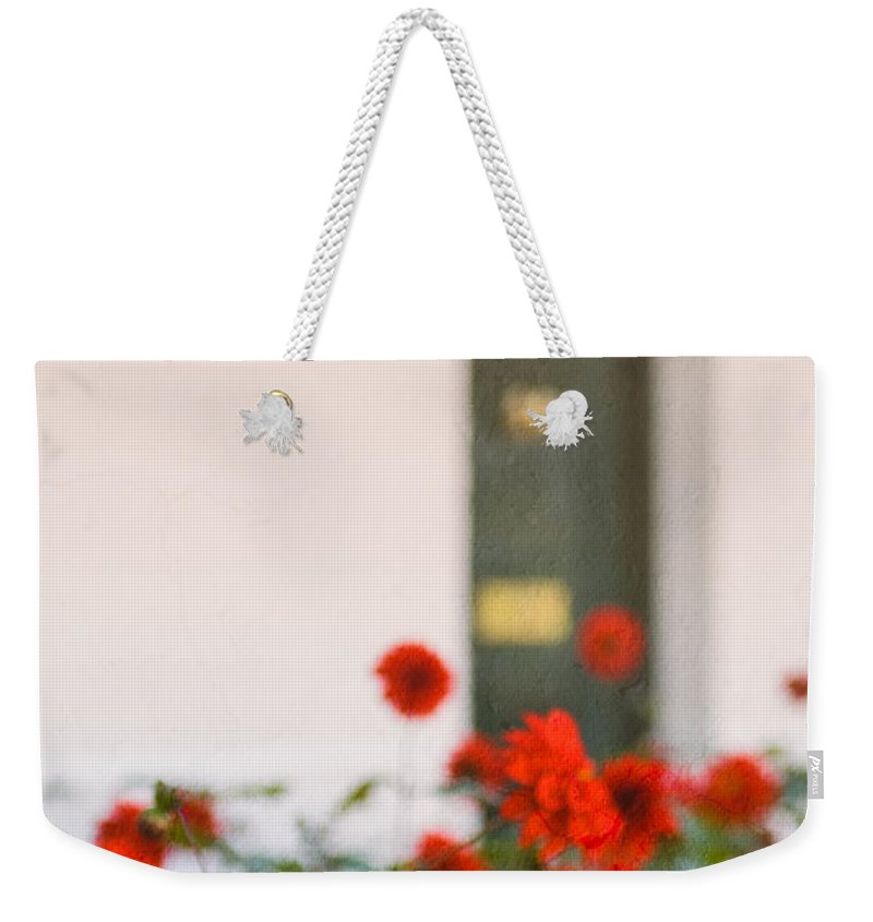 Bud Weekender Tote Bag featuring the photograph Red Flowers by Mark Llewellyn