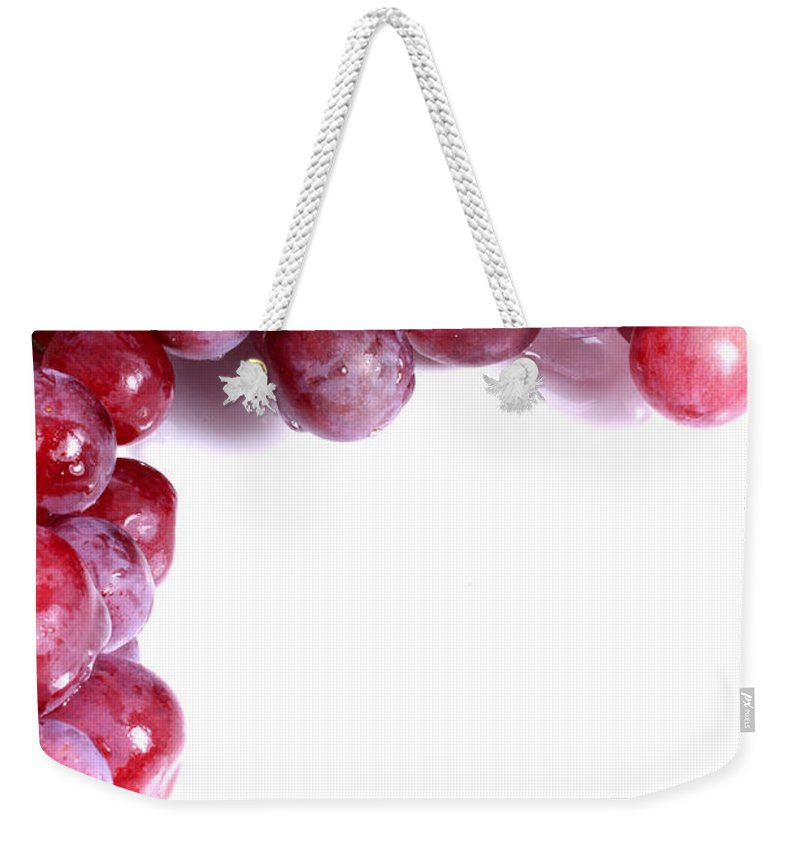 Red Weekender Tote Bag featuring the photograph Red Grapes With White Copy Space by Simon Bratt Photography LRPS