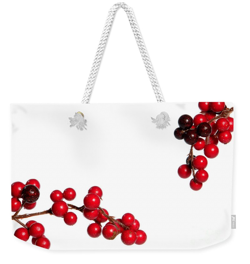 Holly Weekender Tote Bag featuring the photograph Red Holly by Olivier Le Queinec