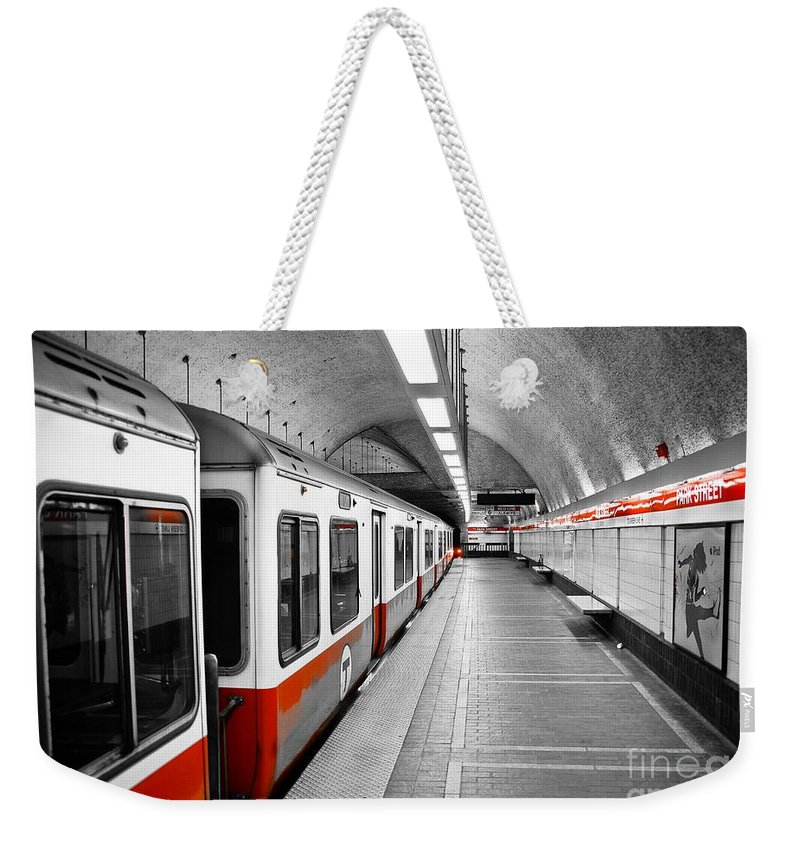 Red Weekender Tote Bag featuring the photograph Red Line by Charles Dobbs