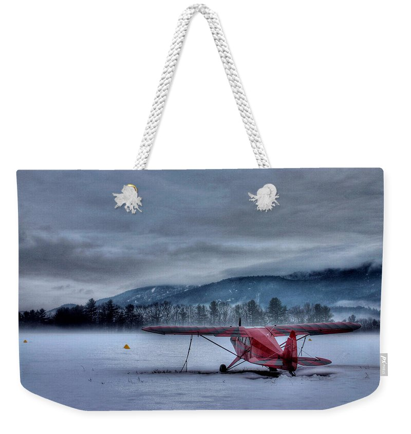 Cloud Weekender Tote Bag featuring the photograph Red Plane In A Gathering Storm by Wayne King