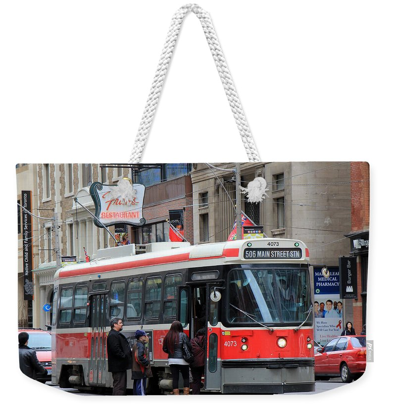 Frans Weekender Tote Bag featuring the photograph Red Rocket 3 by Andrew Fare
