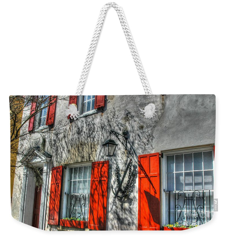Red Shutters Weekender Tote Bag featuring the photograph Pirate House by Dale Powell