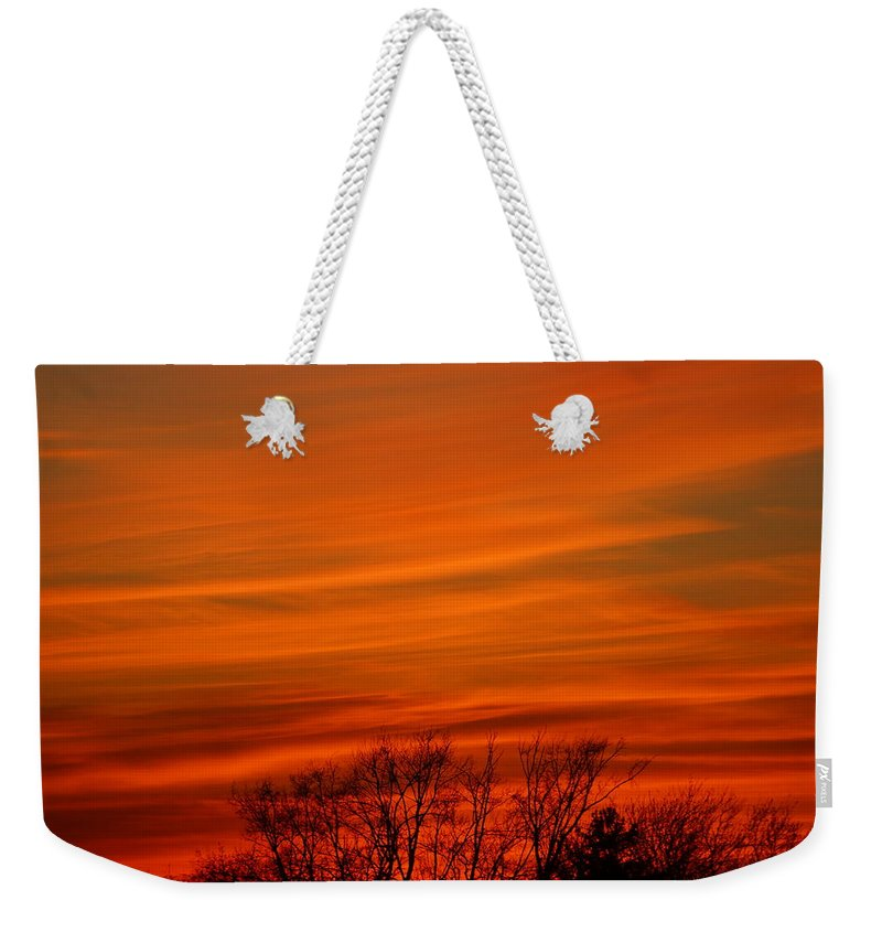 Sunset Weekender Tote Bag featuring the photograph Red Sky by Jeffery L Bowers
