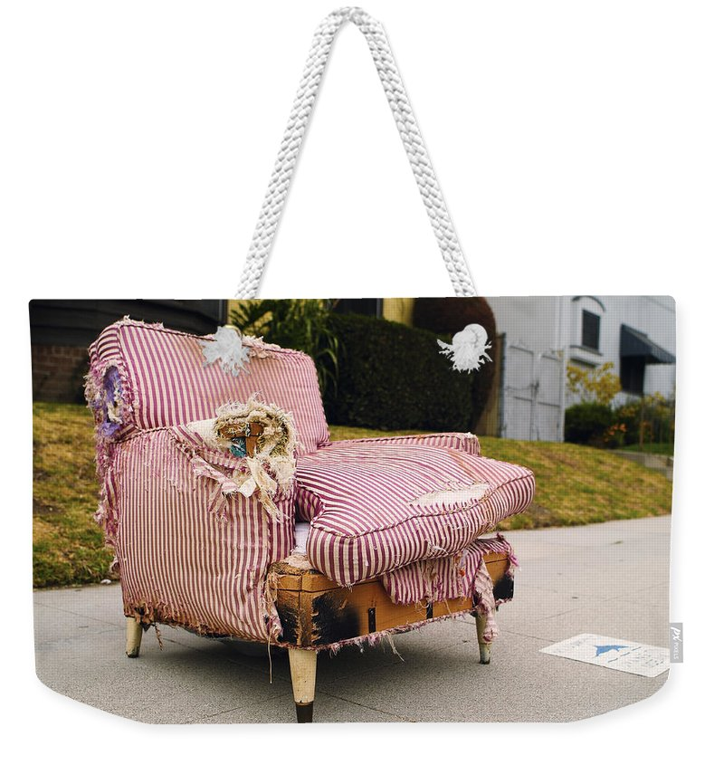 Abandoned Furniture Weekender Tote Bag featuring the photograph Red Striped Chair by Robert Mollett