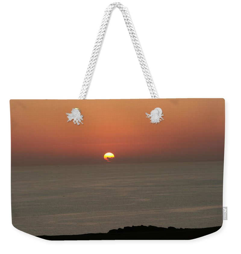 Red Sunset Over Sea Weekender Tote Bag featuring the photograph Red Sunset Over Sea by Gordon Auld