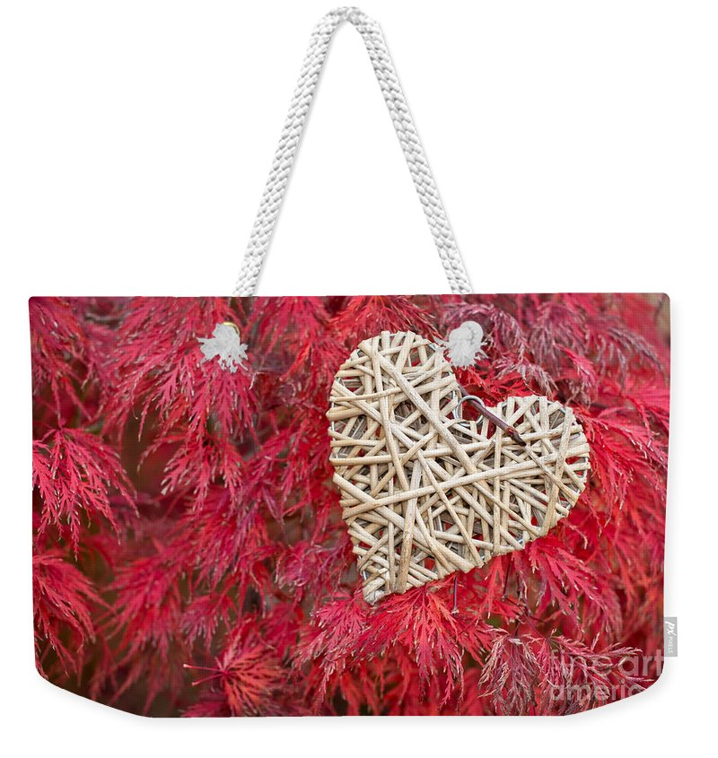 Heart Weekender Tote Bag featuring the photograph Red Valentine by Delphimages Photo Creations