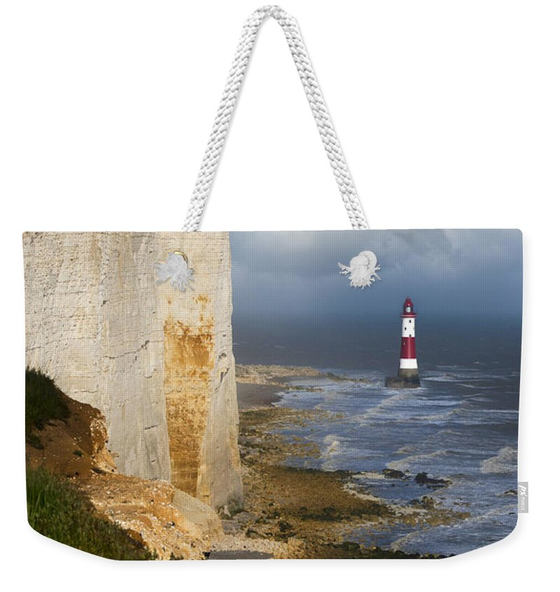Eastbourne Weekender Tote Bag featuring the photograph White Cliffs And Red-white Striped Lightouse In The Sea by Jaroslaw Blaminsky