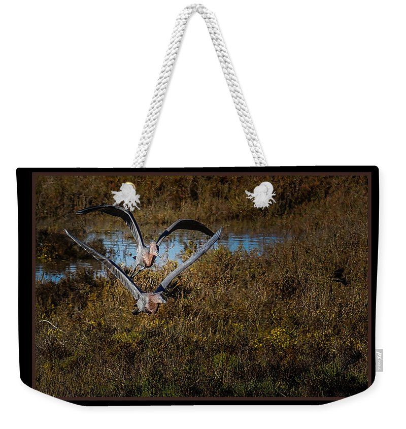Birds Weekender Tote Bag featuring the photograph Reddish Egrets by Ernie Echols