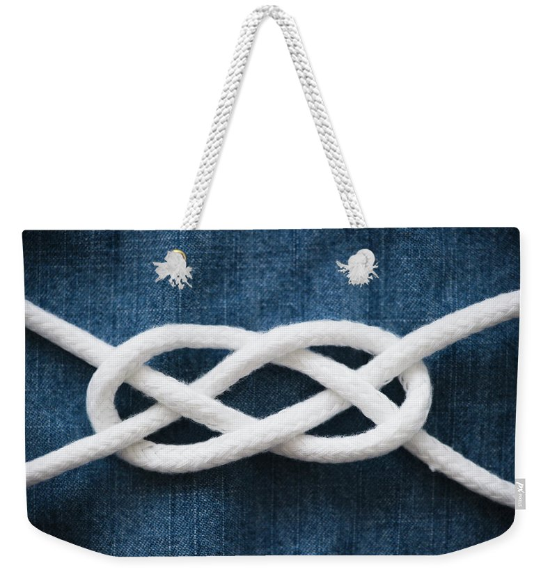 Security Weekender Tote Bag featuring the photograph Reef Knot by Jamie Grill