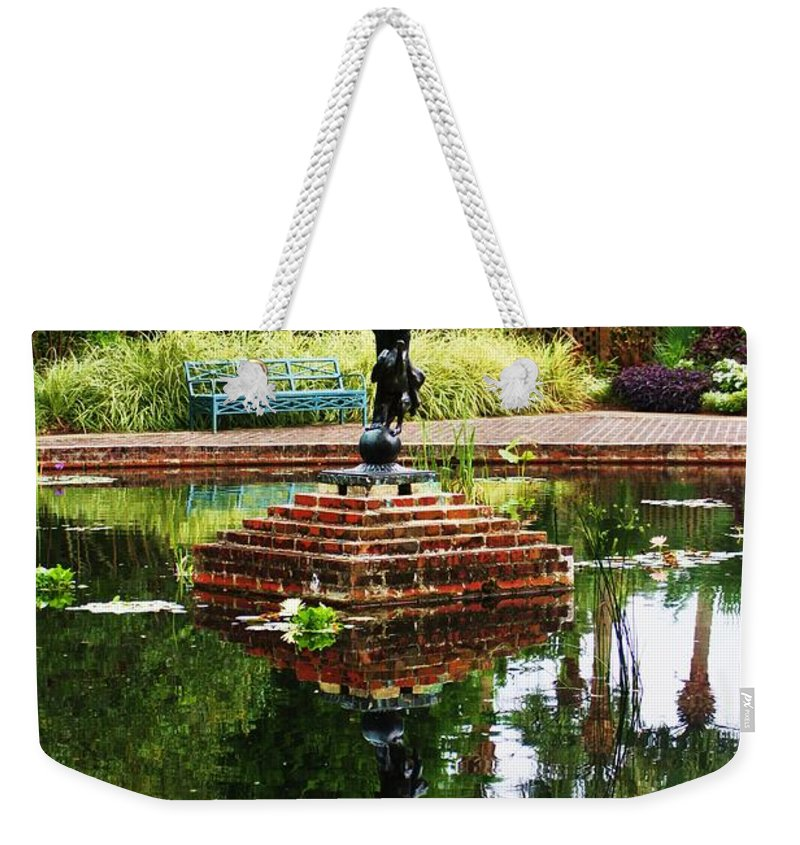 Statue Weekender Tote Bag featuring the photograph Reflected Archer by Chuck Hicks
