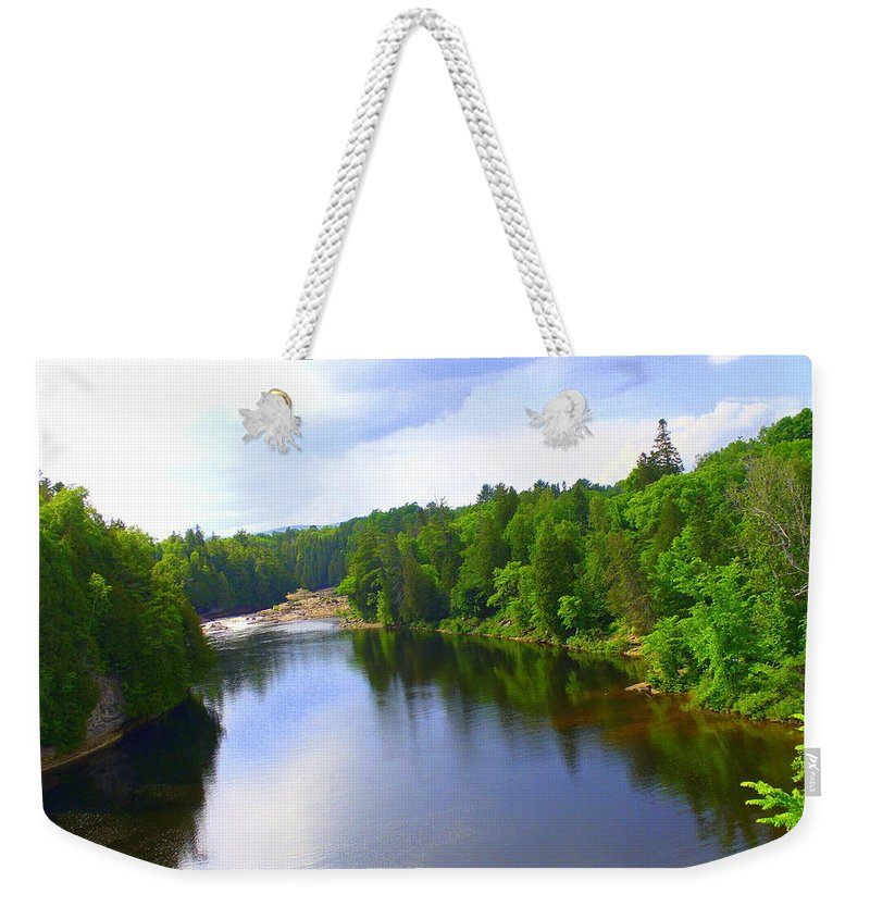 Canadian Landscape Weekender Tote Bag featuring the photograph Reflection In Beaupre Quebec by Lingfai Leung