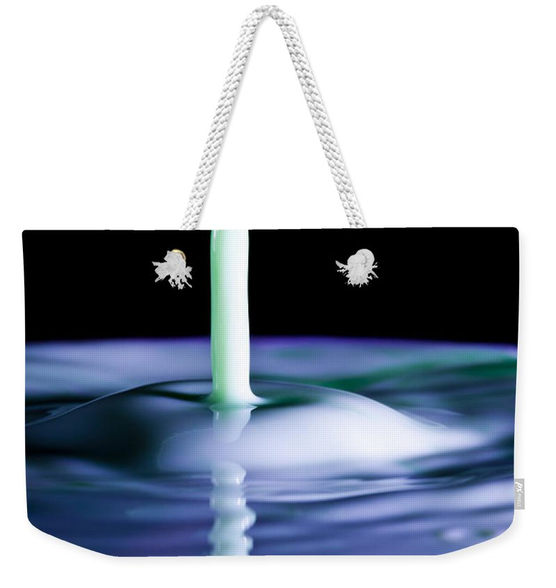 Drop Weekender Tote Bag featuring the photograph Reflection Of A Milk Drop Collision by Marc Garrido