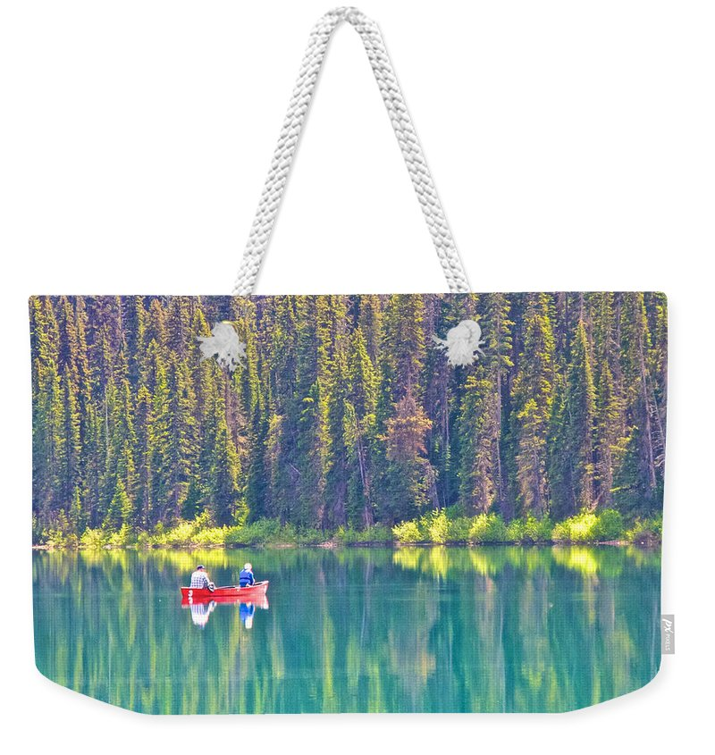 Red Fishing Boat Weekender Tote Bag featuring the photograph Reflective Fishing On Emerald Lake In Yoho National Park-british Columbia-canada by Ruth Hager