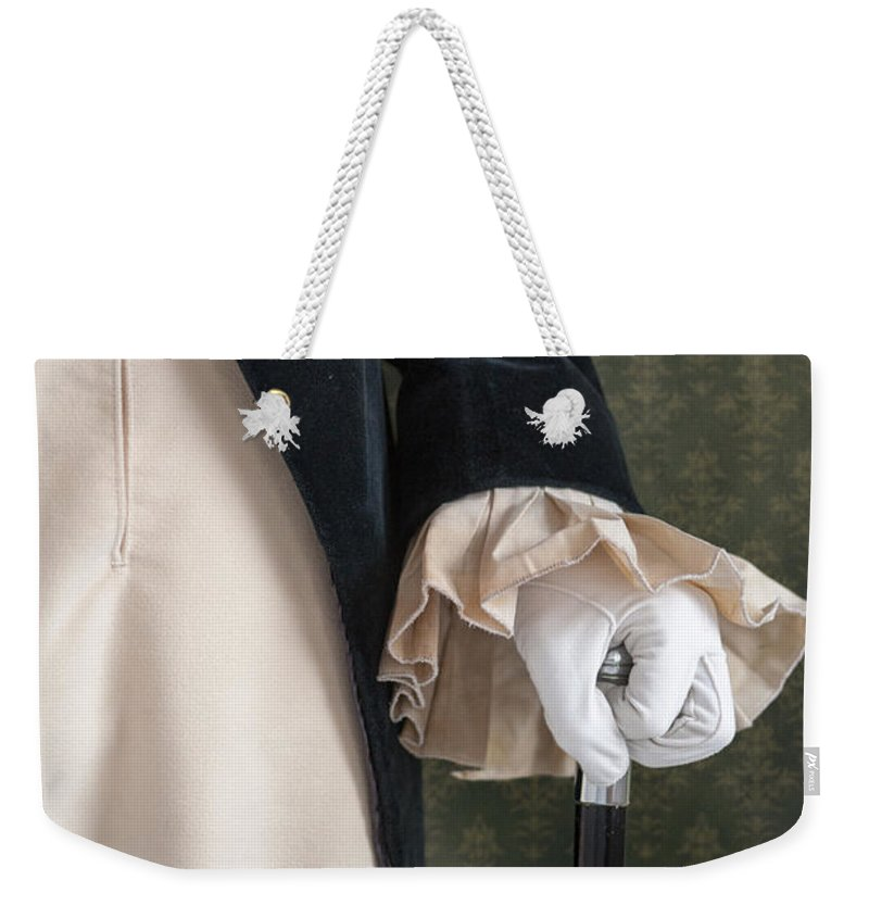 Victorian Weekender Tote Bag featuring the photograph Regency Man Holding A Silver Topped Cane by Lee Avison