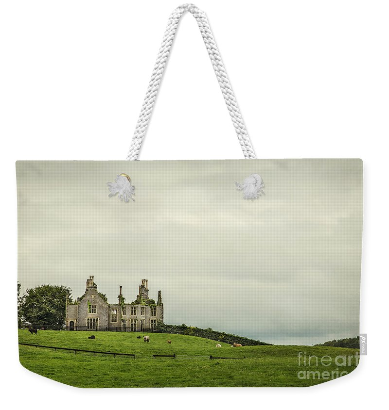 Ireland Weekender Tote Bag featuring the photograph Reign Over Me by Evelina Kremsdorf