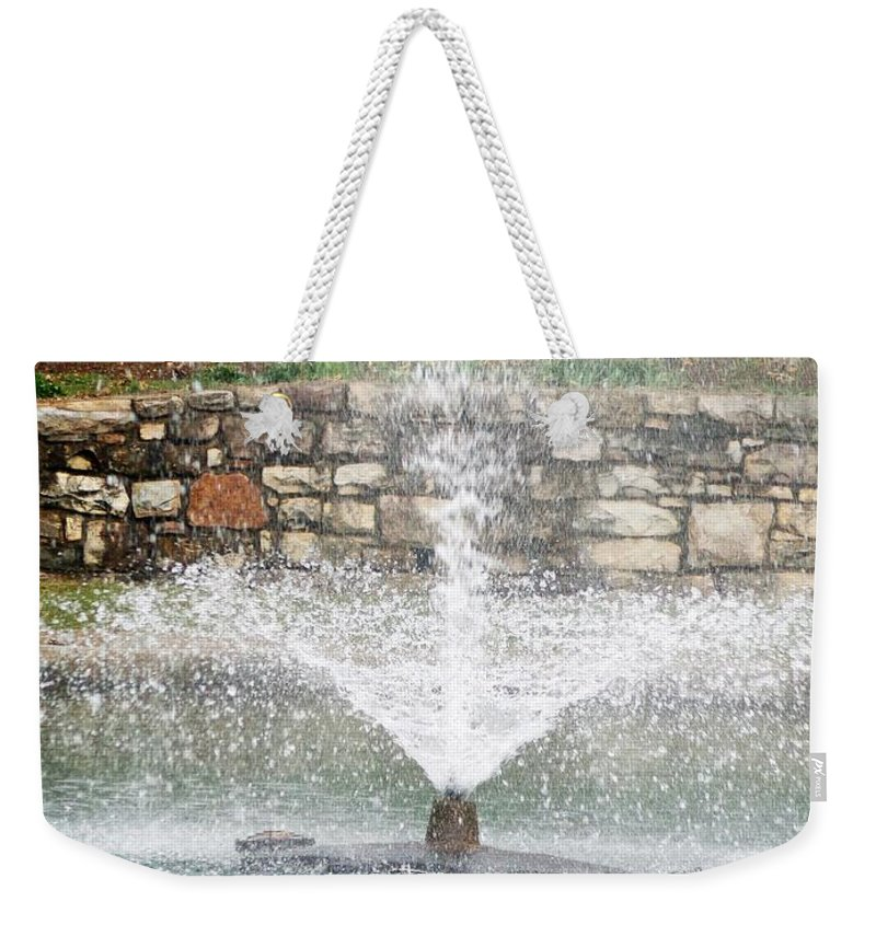 Fountain Weekender Tote Bag featuring the photograph Relaxing In The Park by Jannice Walker
