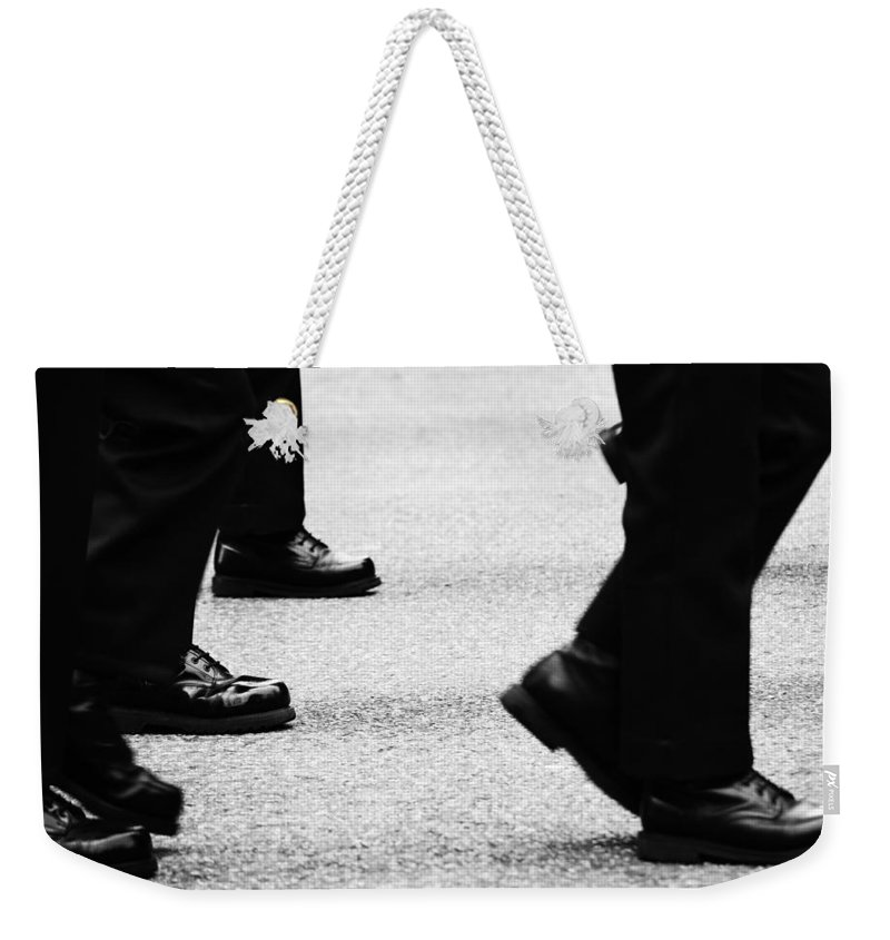Street Photography Weekender Tote Bag featuring the photograph Reluctant March by The Artist Project