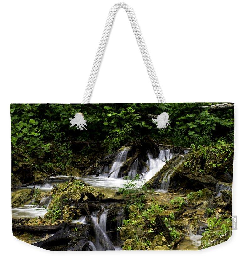 Rural Weekender Tote Bag featuring the photograph Restless Water by Ken Frischkorn