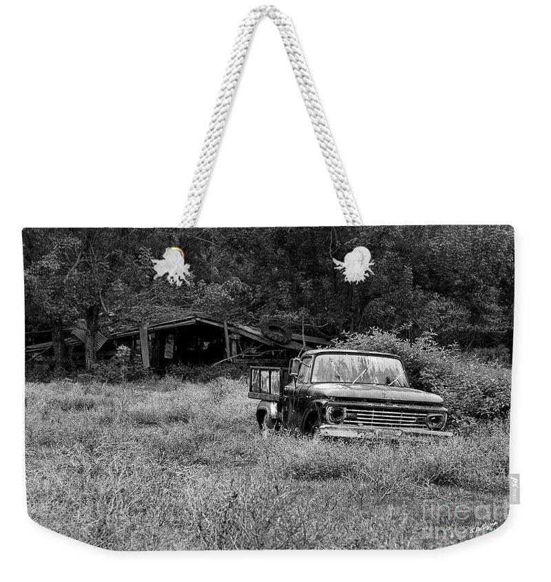 Landscape Weekender Tote Bag featuring the photograph Retired by Scott Pellegrin