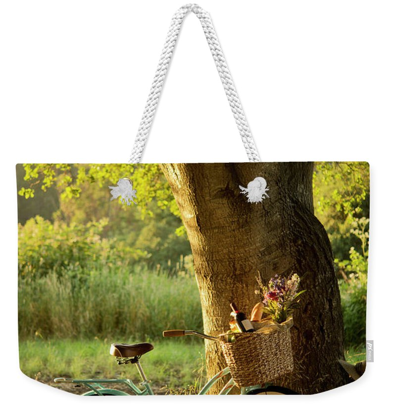 Grass Weekender Tote Bag featuring the photograph Retro Bicycle With Red Wine In Picnic by Nightanddayimages