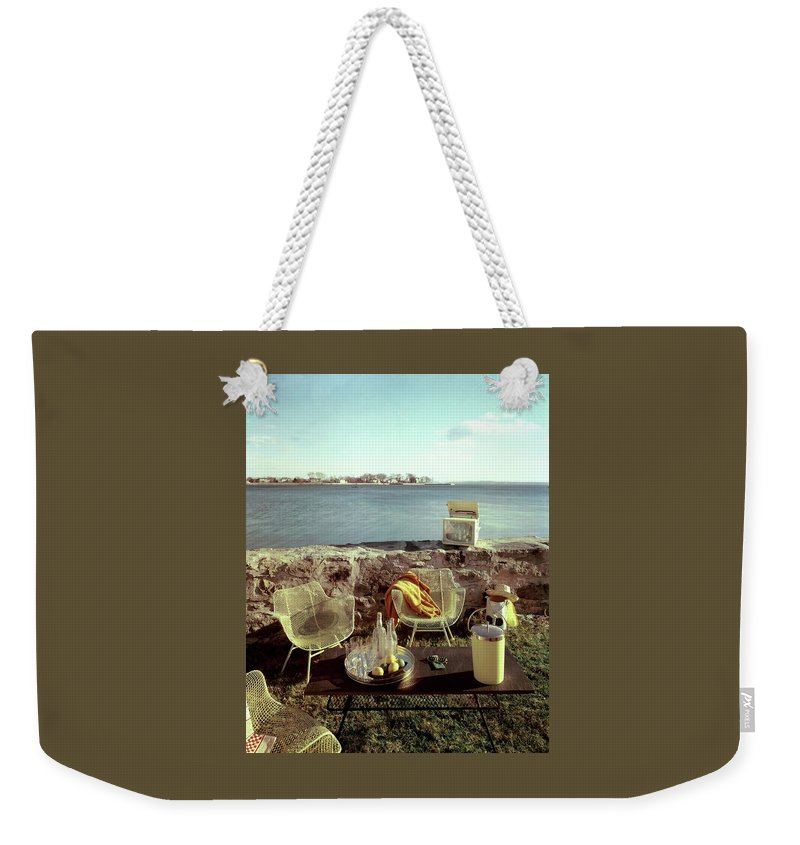 Outdoors Weekender Tote Bag featuring the photograph Retro Outdoor Furniture by Fred Lyon