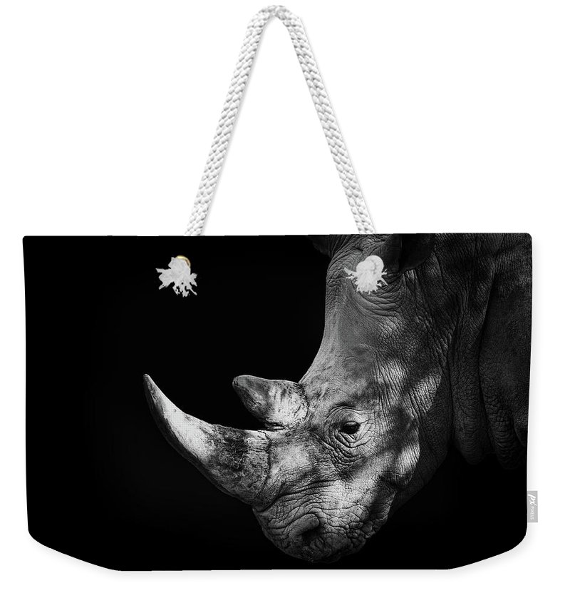 Horned Weekender Tote Bag featuring the photograph Rhinoceros by Malcolm Macgregor
