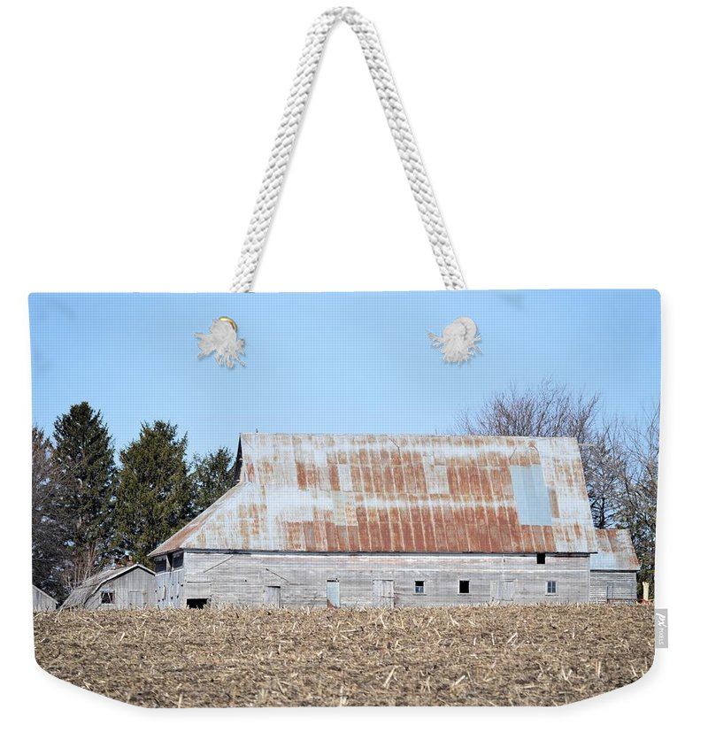 Rust Weekender Tote Bag featuring the photograph Ribbon Roof Barn by Bonfire Photography
