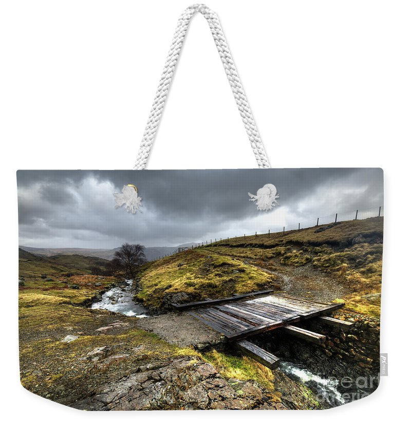 Rickety Weekender Tote Bag featuring the photograph Rickety Bridge On Honiston Pass by Rob Hawkins