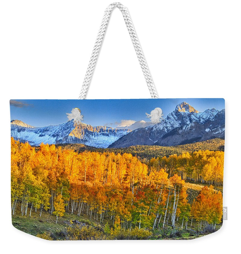Colorado Weekender Tote Bag featuring the photograph Ride Into The Color by Scott Mahon