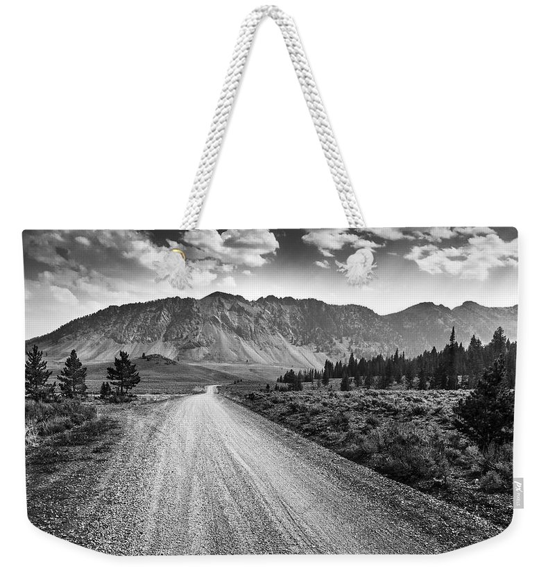 Idaho Weekender Tote Bag featuring the photograph Riding To The Mountains by Eric Benjamin