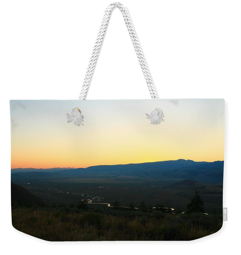 Jackson Hole Weekender Tote Bag featuring the photograph River And Mountains by Catie Canetti