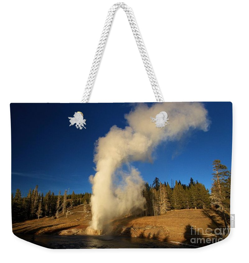Riverside Geyser Weekender Tote Bag featuring the photograph River Eruption by Adam Jewell