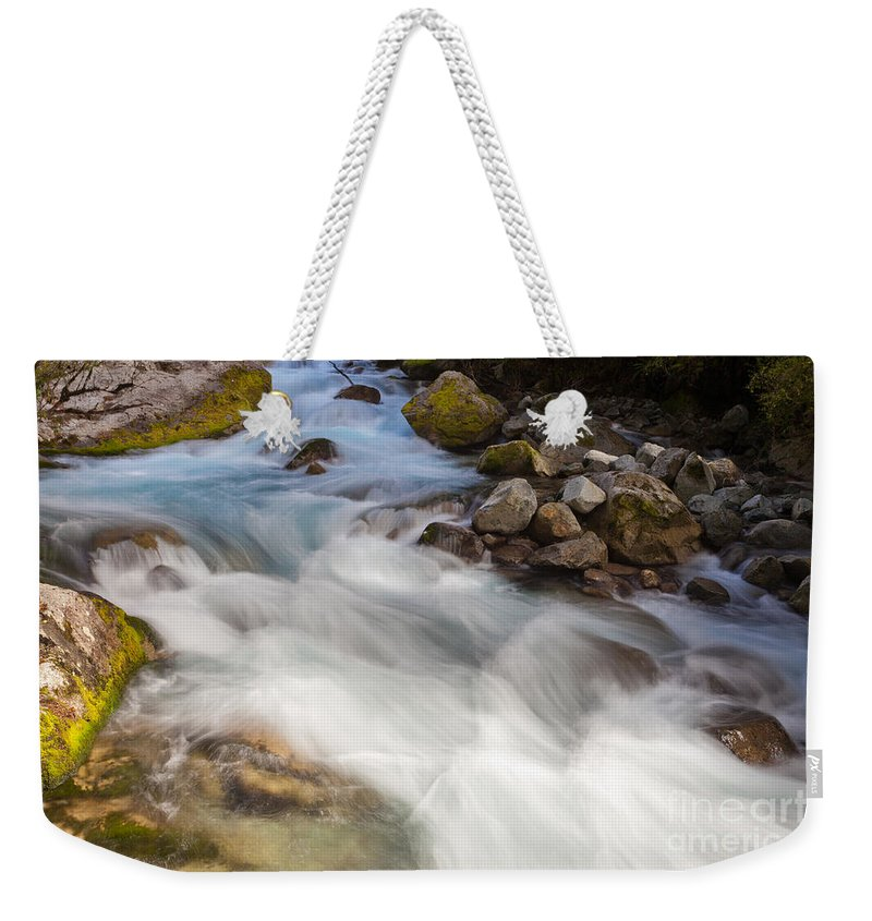 Cascade Weekender Tote Bag featuring the photograph River Rapids Washing Over Rocks With Silky Look by Stephan Pietzko