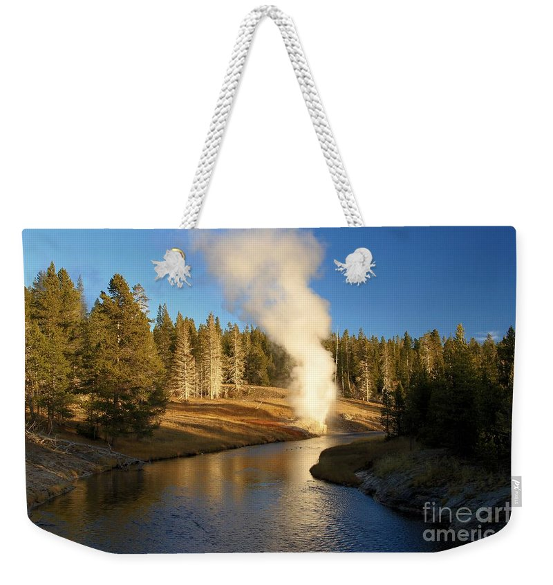 Riverside Geyser Weekender Tote Bag featuring the photograph Riverside Reflection by Adam Jewell