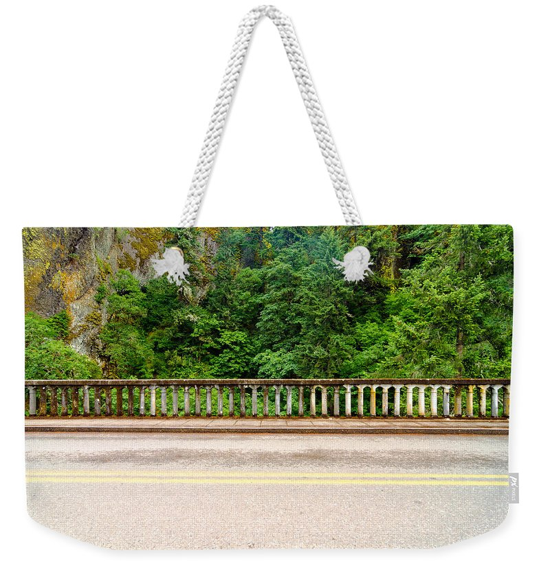 Nature Weekender Tote Bag featuring the photograph Road And Lush Green Forest by Jess Kraft