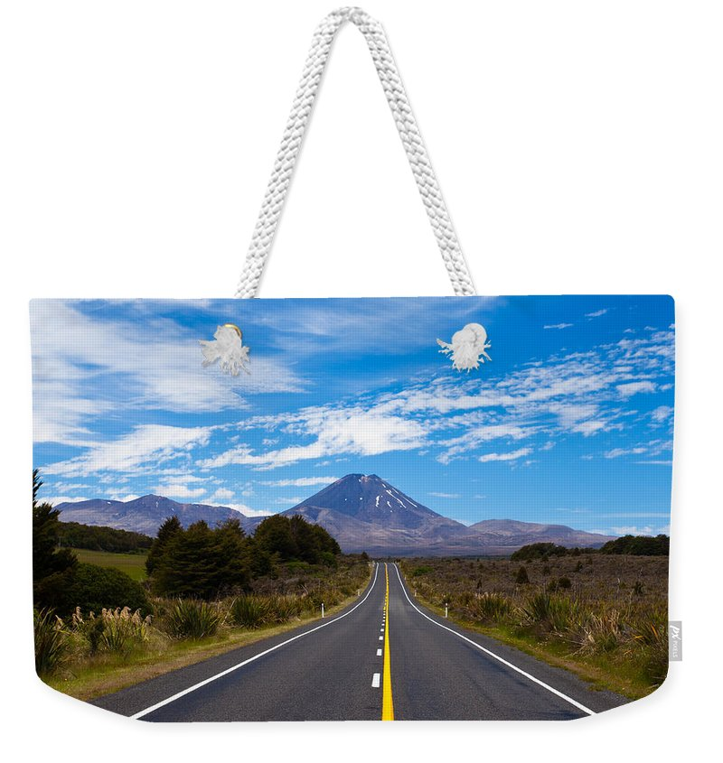 Mount Weekender Tote Bag featuring the photograph Road Leading To Active Volcanoe Mt Ngauruhoe Nz by Stephan Pietzko
